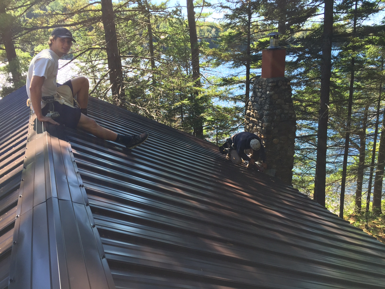 A beautiful day with Nan feeling it and Bill finishing up the caulking near the chimney